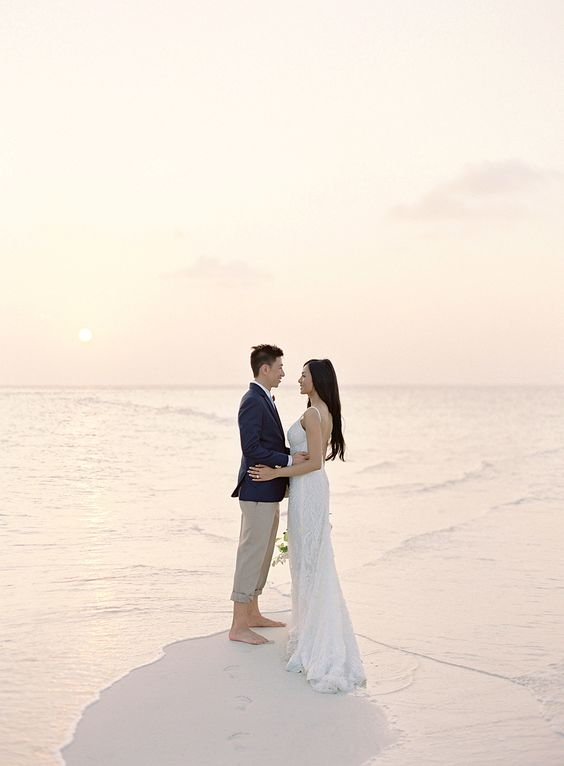 A BAREFOOT CEREMONY ON A SANDBAR WITH 360 DEGREE OCEAN VIEWS / Maldives destination wedding