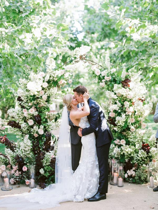 California wedding with floral arbor